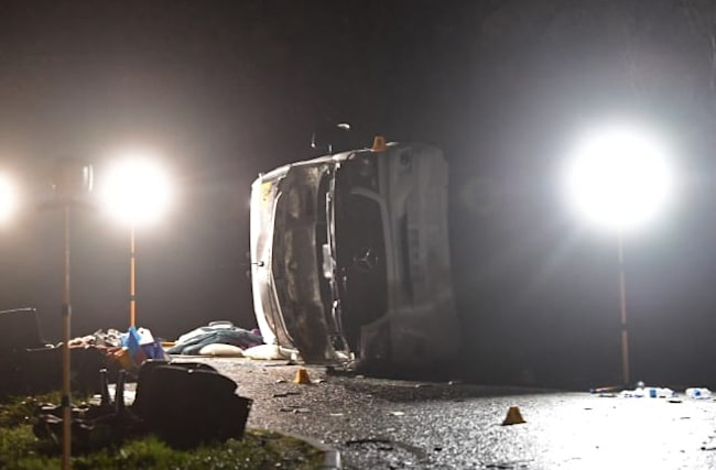One dead and 19 taken to hospital after minibus overturns