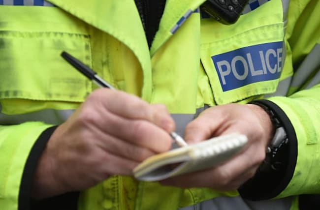 Boy, 14, charged with spitting at woman during crisis