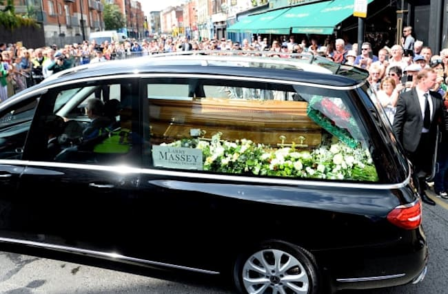 Crowds line streets to say goodbye to Father Ted star