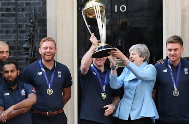 England's World Cup heroes present Theresa May with trophy