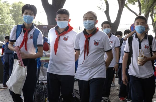 In pictures: The coronavirus sweeps the globe