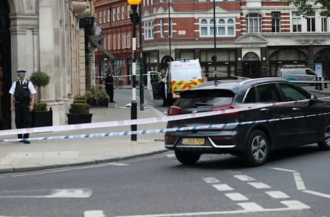 Man arrested after car hits two people in central London