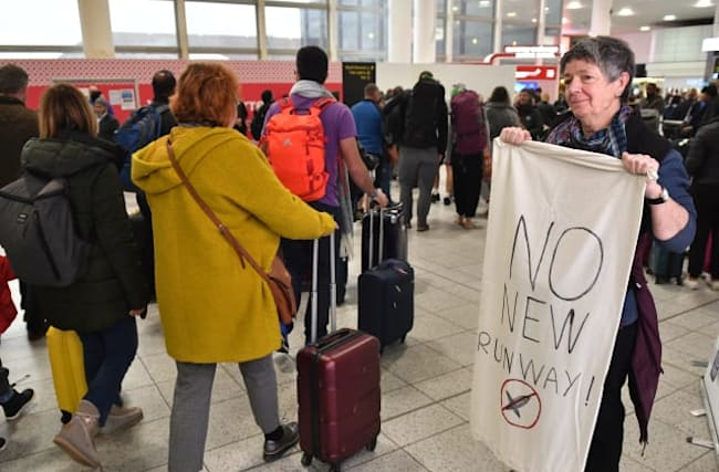 Extinction Rebellion stage flights pollution protest at Gatwick
