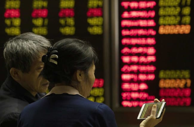 US stock indexes close at record high amid hope of China-US trade deal