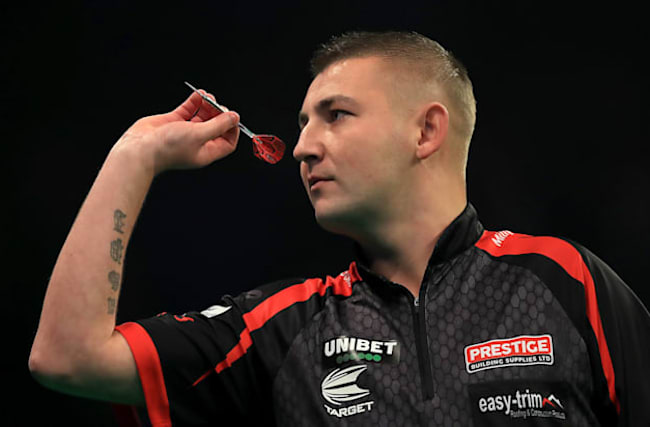 Nathan Aspinall triumphs in second round of Darts at Home