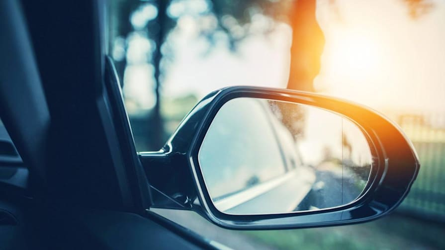 Teenager rids cars of blind spots using a webcam and projector