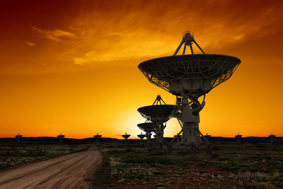 large radio telescopes in silhouette at sunset (XL)