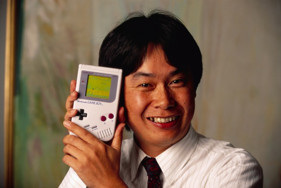 Shigeru Miyamoto, creator of Mario and other characters and video games for Nintendo, holds a Nintendo Game Boy containing the Super Mario World video game. (Photo by © Ralf-Finn Hestoft/CORBIS/Corbis via Getty Images)