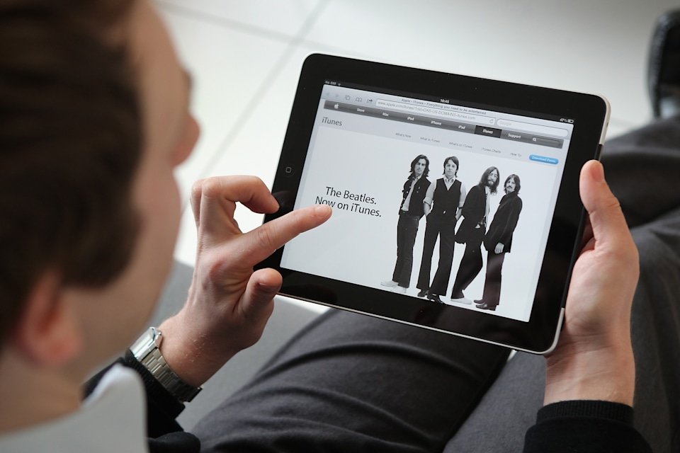 LONDON, ENGLAND - FEBRUARY 17:  In this photo illustration, a man uses an Apple ipad tablet on February 17, 2011 in London, England. Apple sold two million ipads in the first two months of their launch in 2010. Worldwide iPad sales are expected to amount to 20 million in 2012.  (Photo Illustration by Peter Macdiarmid/Getty Images)