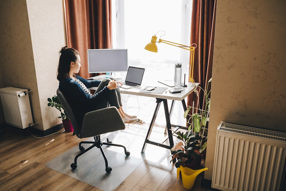 woman working at home. telework on laptop. copy space