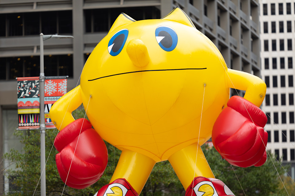 Houston, Texas, USA - November 28, 2019: H-E-B Thanksgiving Day Parade, large balloon in the shape of pac-man going down Milam Street during the parade