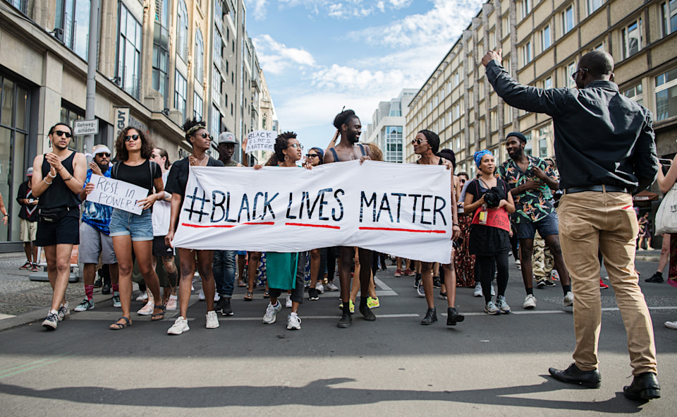 "Demonstrators held a banner with the motto of the black civil rights movement with the twitter hashtag ""#Black Lives Matter"" to show their solidarity worldwide with African Americans in the US in Berlin, Germany, 10 July 2016. In the US, there were nationwide protests after the death of two African American by police shots. On the night of Friday 07 July 2016 the situation escalated. A sniper shot dead five police and injured two civilians during a demonstration against police violence in Dallas, Texas. Photo: WOLFRAM KASTL/dpa 