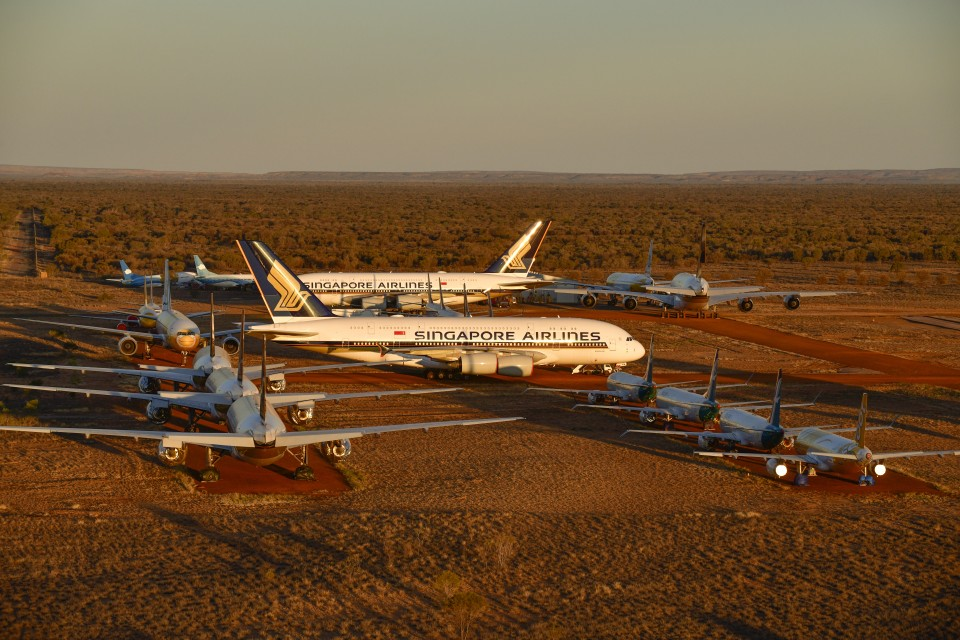 ALICE SPRINGS, AUSTRALIA - MAY 15: Grounded aeroplanes which include Airbus A380s, Boeing MAX 8s and other smaller aircrafts are seen at the Asia Pacific Aircraft Storage facility on May 15, 2020 in Alice Springs, Australia. The number of passenger planes housed at the Asia Pacific Aircraft Storage facility has increased due to the Coronavirus (COVID-19) pandemic with at least four Airbus A380 planes grounded there, the first time the aircraft has landed at Alice Springs. (Photo by Steve Strike/Getty Images)
