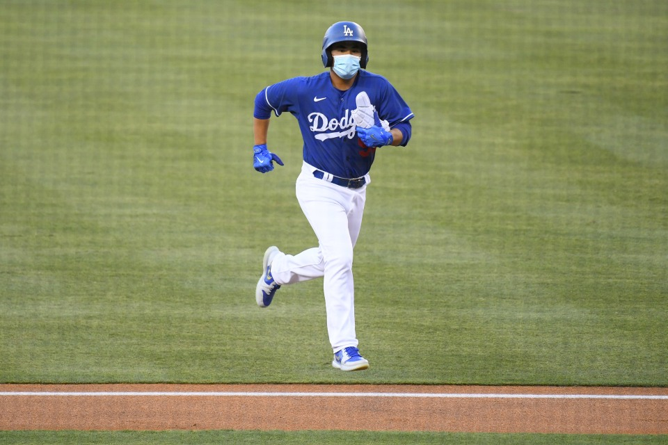 """LOS ANGELES, CA - JULY 20: Los Angeles Dodgers Francisco """"Chico"""" Herrera runs back to the dugout during a MLB exhibition game between the Arizona Diamondbacks and the Los Angeles Dodgers on July 20, 2020 at Dodger Stadium in Los Angeles, CA. (Photo by Brian Rothmuller/Icon Sportswire via Getty Images)"""