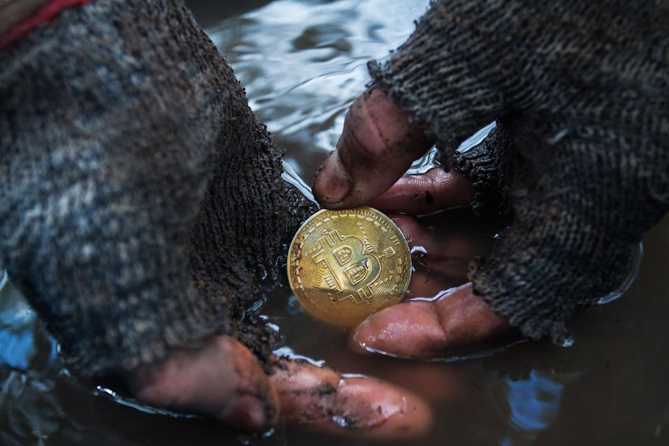 March 10, 2018 Thailand, Koh phangan: Dirty man's hands found in the ground a bitcoin coin. Photo was taken during the shooting of a short film on the topic of cryptocurrency Denis Kartavenko for his project on YouTube