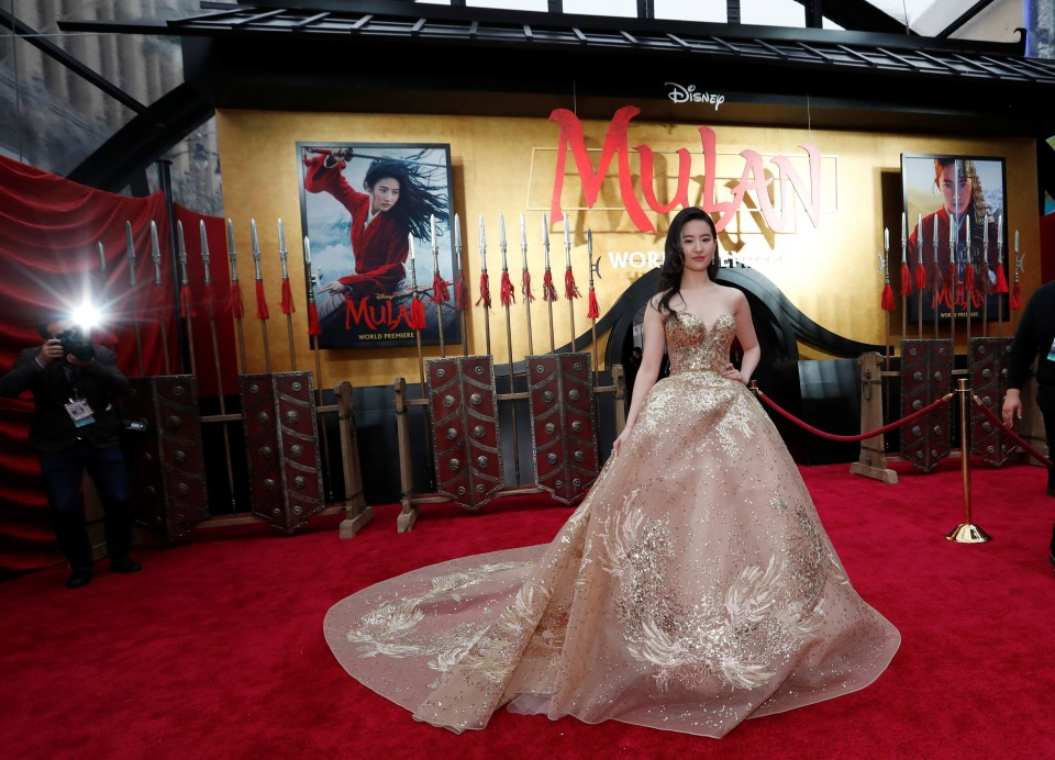 """Cast member Liu Yifei poses at the premiere for the film """"Mulan"""" in Los Angeles, California, U.S., March 9, 2020. REUTERS/Mario Anzuoni"""
