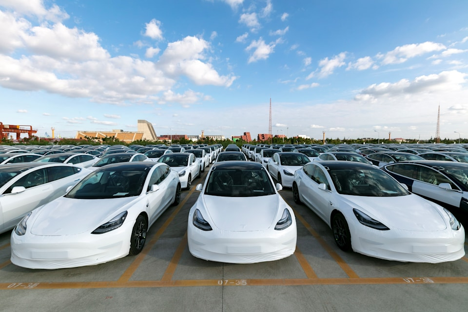 SHANGHAI, Oct. 19, 2020 -- Photo taken on Oct. 19, 2020 shows the Tesla China-made Model 3 vehicles which will be exported to Europe at Waigaoqiao port in Shanghai, east China, Oct. 19, 2020. U.S. carmaker Tesla announced on Monday that it would export the made-in-China Model 3 to Europe, marking another important milestone for its Shanghai Gigafactory.     The first batch of exported sedans will leave Shanghai next Tuesday and arrive at the port of Zeebrugge in Belgium at the end of November before being sold in European countries, including Germany, France, Italy, Spain, Portugal, and Switzerland. (Photo by Wang Xiang/Xinhua via Getty) (Xinhua/Wang Xiang via Getty Images)
