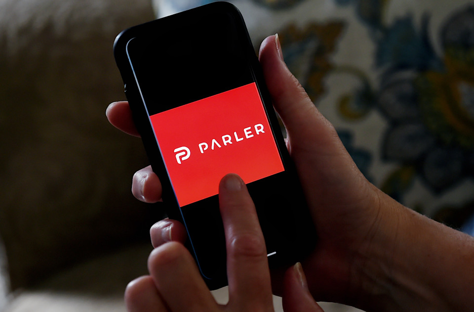 "This illustration picture shows social media application logo from Parler displayed on a smartphone in Arlington, Virginia on July 2, 2020. - Amid rising turmoil in social media, recently formed social network Parler is gaining with prominent political conservatives who claim their voices are being silenced by Silicon Valley giants. Parler, founded in Nevada in 2018, bills itself as an alternative to ""ideological suppression"" at other social networks. (Photo by Olivier DOULIERY / AFP) (Photo by OLIVIER DOULIERY/AFP via Getty Images)"