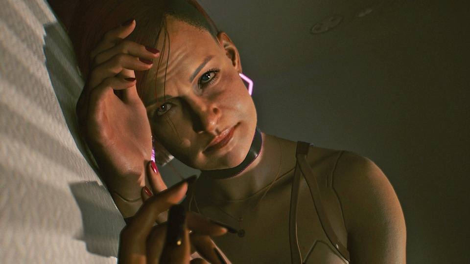 A screenshot taken from Cyberpunk 2077 video game showing a female laying on their side.