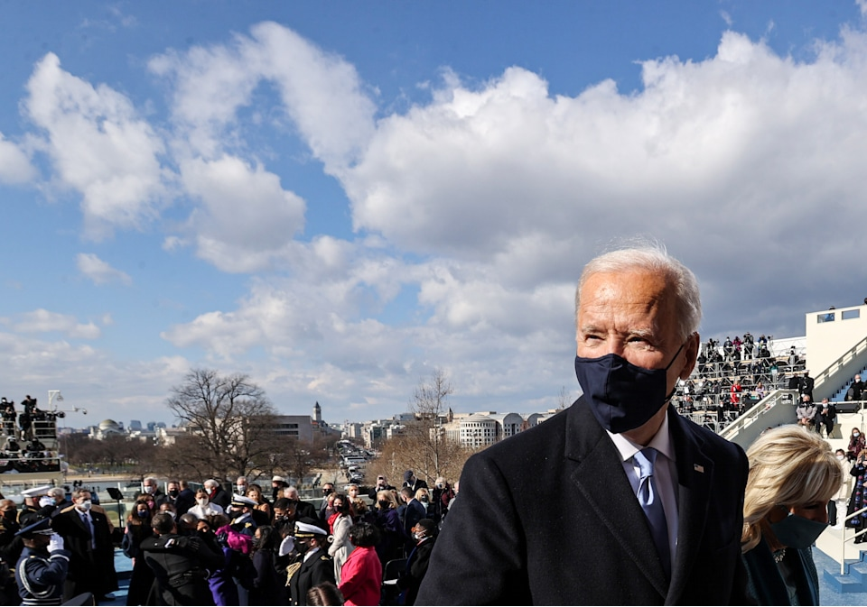 US President Joe Biden and first lady Jill Biden leave after the 59th presidential inauguration on January 20, 2021, at the US Capitol in Washington, DC. (Photo by JONATHAN ERNST / POOL / AFP) (Photo by JONATHAN ERNST/POOL/AFP via Getty Images)