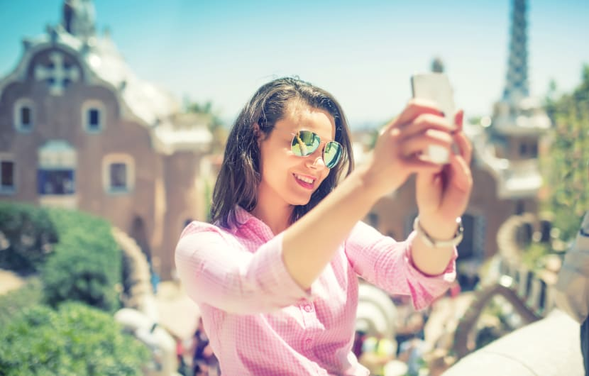 Attractive woman taking selfie with smart phone, mobile phone. Modern concept of photography, selfie, beautiful woman taking pic