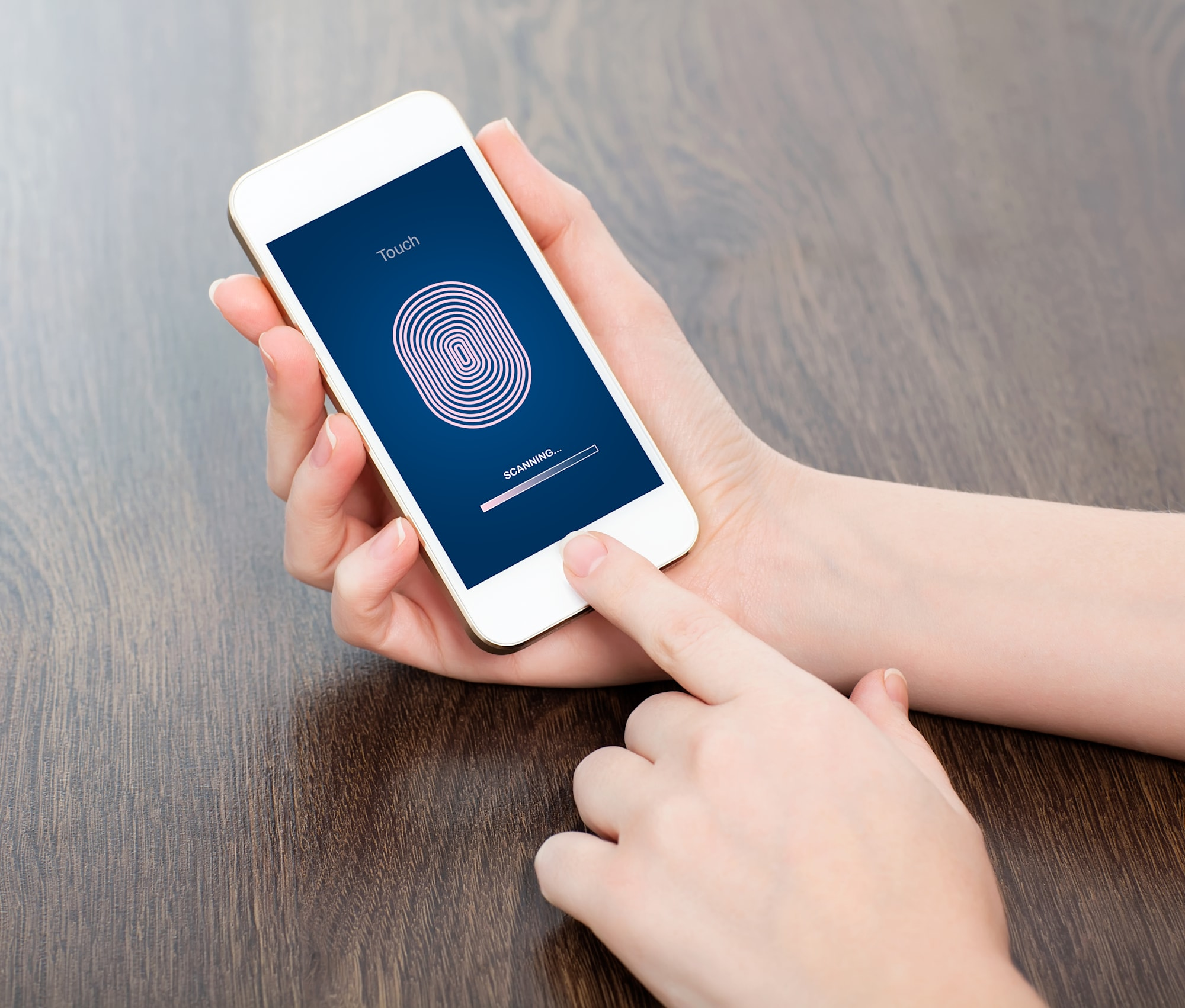female hands holding phone and entering PIN code of finger