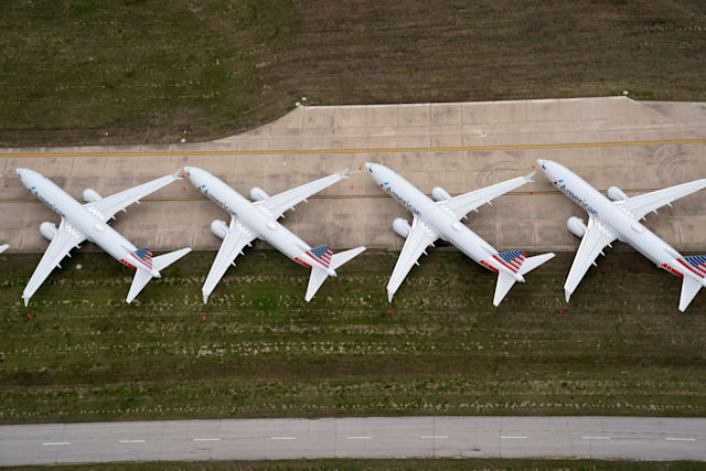 American Airlines 737 max passenger planes are parked on the tarmac at Tulsa International Airport in Tulsa, Oklahoma, U.S. March 23, 2020. REUTERS/Nick Oxford TPX IMAGES OF THE DAY REFILE - CORRECTING PLANE MODEL AND SLUG, REMOVING REFERENCE TO CORONAVIRUS