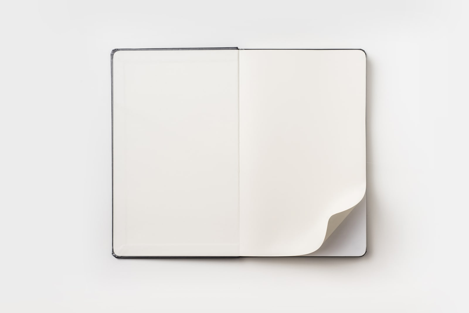 Directly Above View Of Open Book On White Background