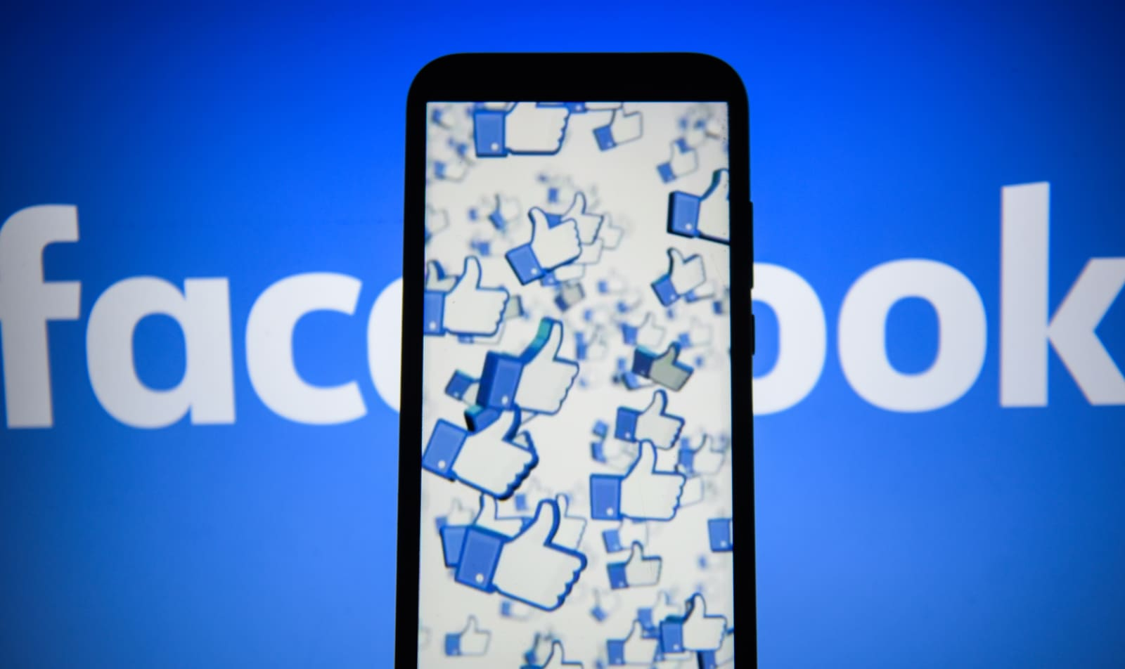 Facebook likes logo are seen on an android mobile phone