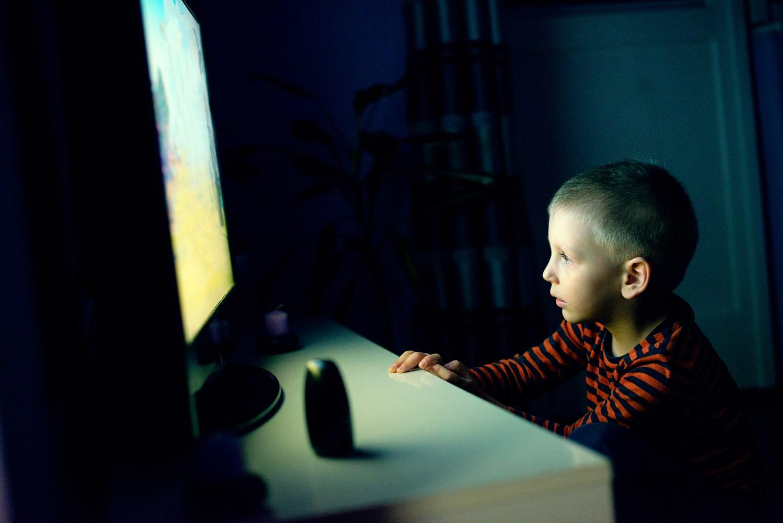 Cute boy watching cartoon