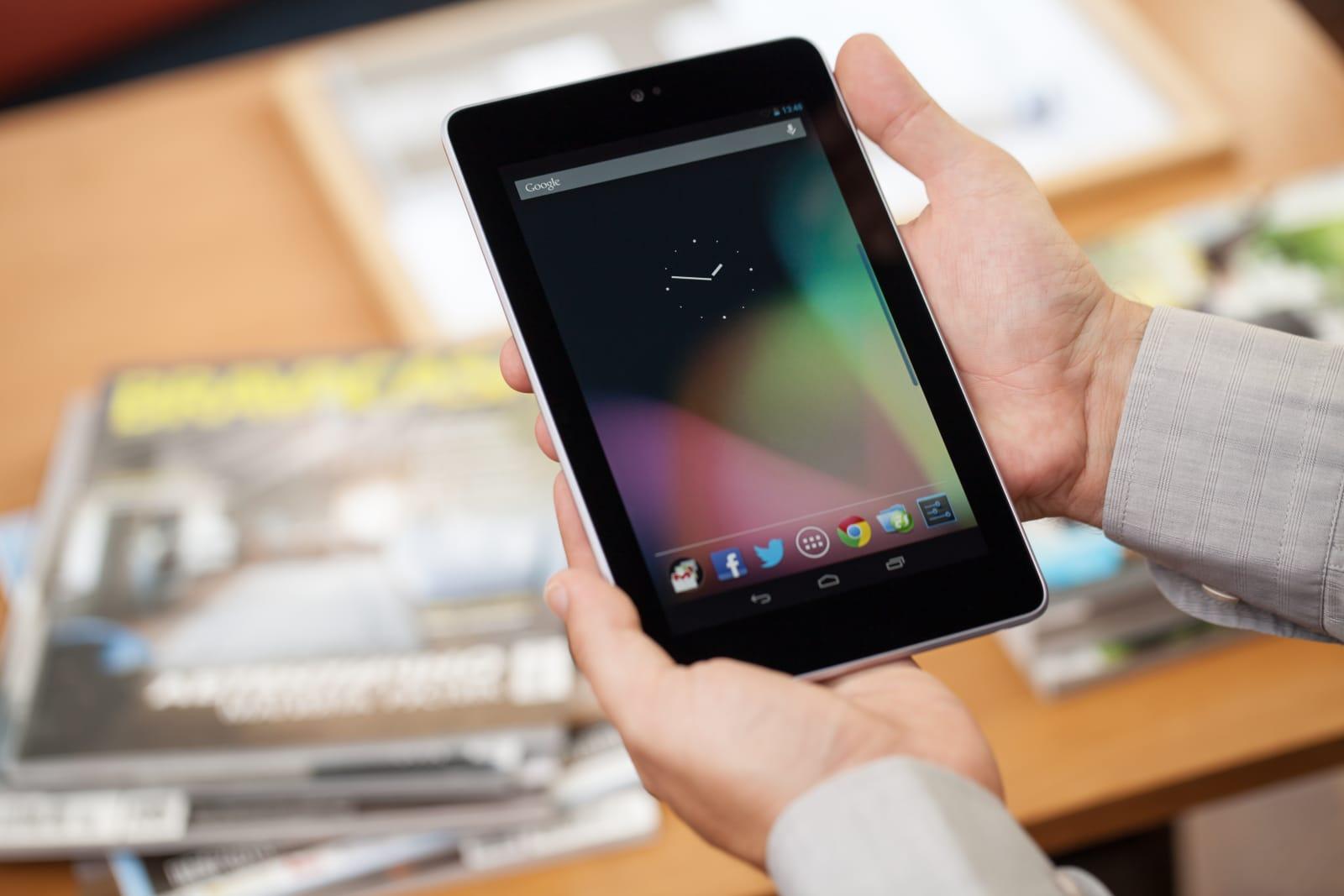 Man holding Google Nexus 7 digital tablet
