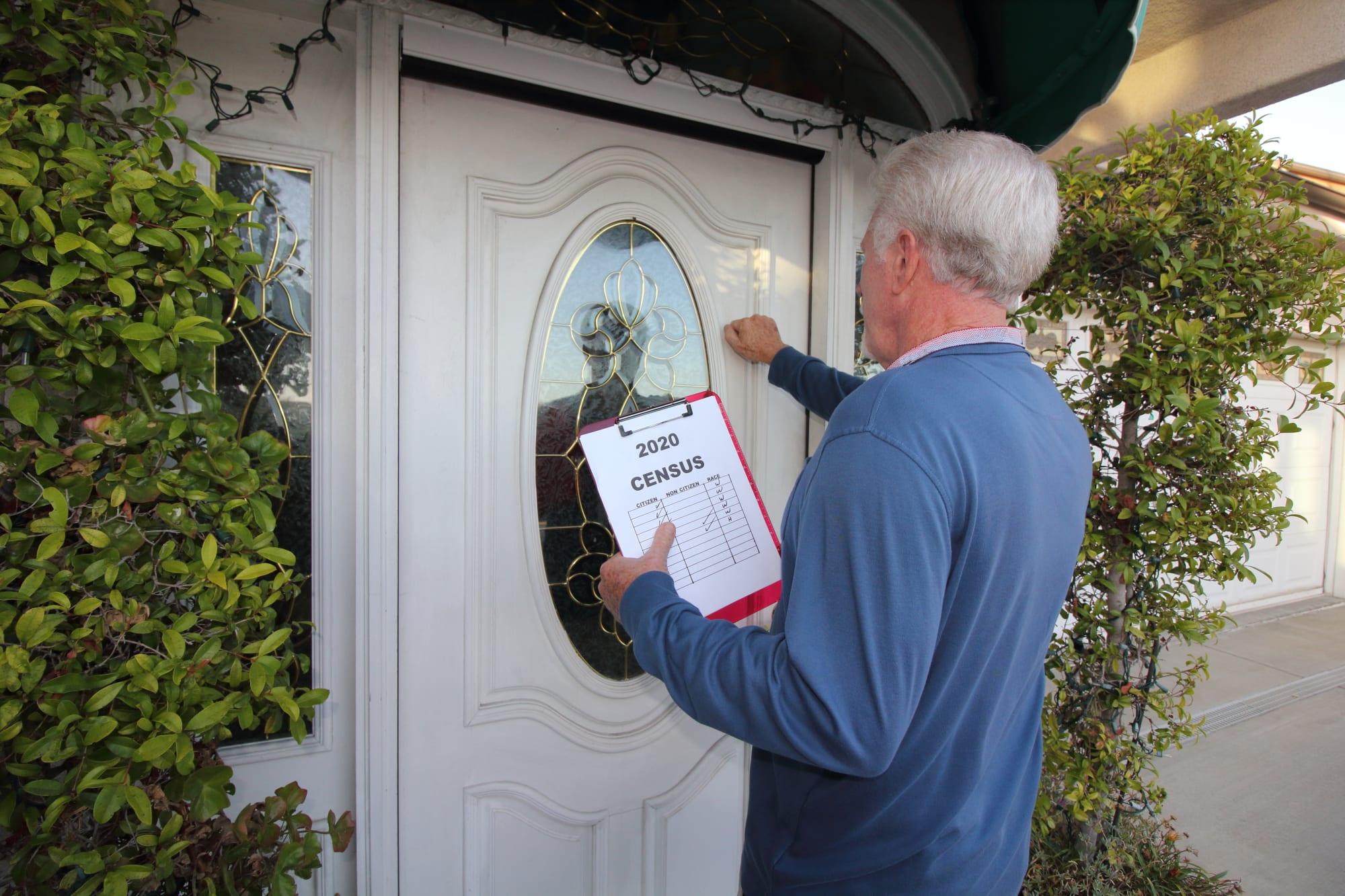 Man Canvassing Door to Door for the 2020 Census